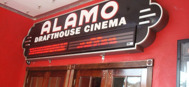 Enjoying a movie at the original Alamo Drafthouse Cinema in Austin