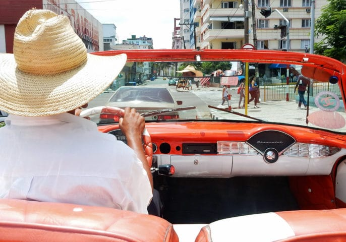 Cruising through the streets of Havana in a 1956 Chevy convertible